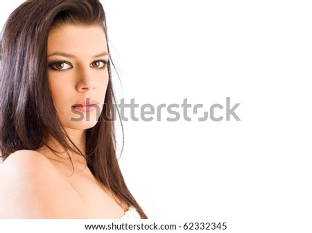 Beauty shot of young brunette in front of white background.