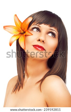 Beauty shot of young caucasian woman with flower in her hair, isolated on white