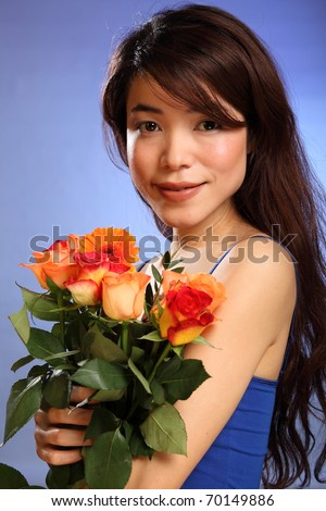 Beauty shot young Japanese girl holding flowers
