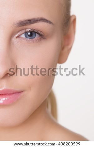 Beauty Skin care concept, Beautiful woman face with nude make-up isolated on grey background, caucasian model - stock photo