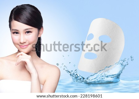 Beauty Skin care concept, Beautiful woman face with Water splashes and cloth facial mask isolated on blue background, asia - stock photo