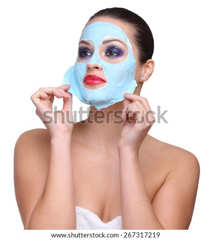 Beauty skin care cosmetics and health concept. Closeup young woman face, girl removing facial peel off mask isolated on white. Peeling. - stock photo
