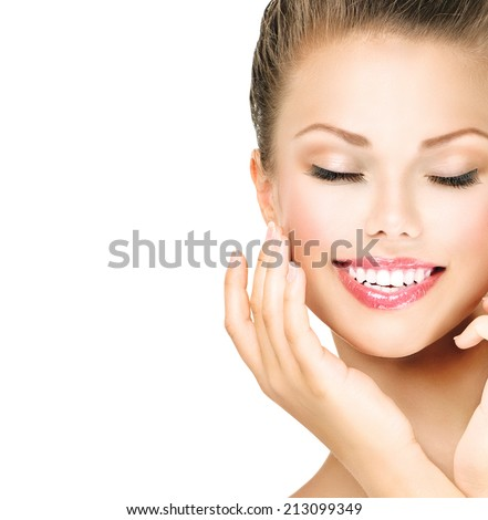 Beauty skin care Woman Smiling with closed eyes Close-up Portrait. Pretty model girl touching her cheek with Finger Isolated on White Background. Perfect pure skin. Fresh Clean Skin. - stock photo