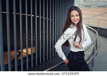 Beauty smiling business girl (teacher, student, schoolgirl) - stock photo