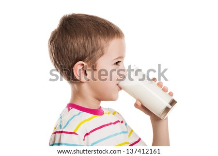 Beauty smiling child boy hand holding milk drink glass white isolated - stock photo
