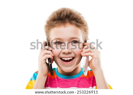 Beauty smiling child boy hand holding two mobile phones or talking pair of smartphones white isolated - stock photo