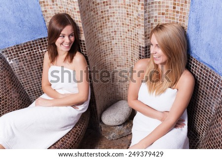 Beauty smiling friends relaxing in wellness center - stock photo