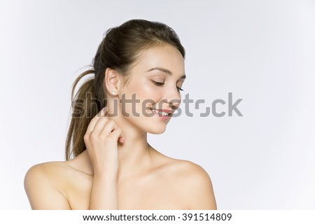 Beauty smiling girl portrait . Beautiful woman face. Isolated on a white background. Pretty Girl Touching her neck - stock photo