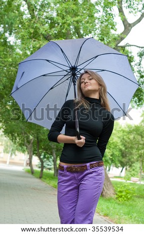 beauty smiling girl stay in the park on trees background - stock photo