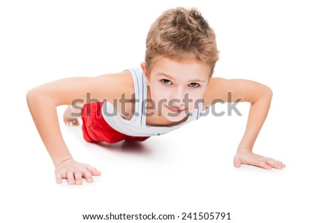 Beauty smiling sport child boy press up exercising white isolated
