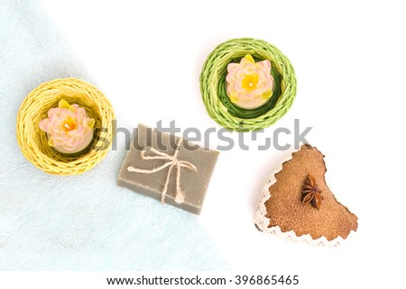 Beauty spa, bath bomb, aroma cosmetic soap with towel, candles, heart and soap bar. Natural aromatherapy ball for care, wellness, health, treatment, hygiene, relaxation. Relax bathroom. - stock photo