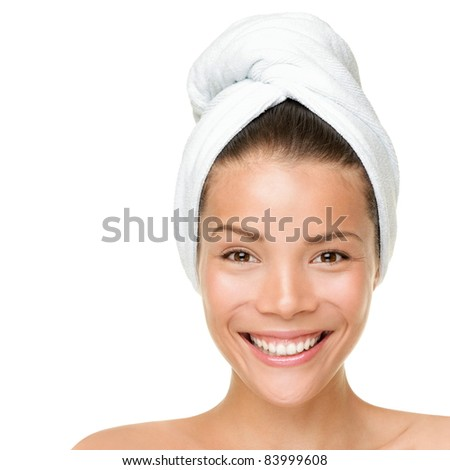 Beauty spa treatment woman wearing towel drying hair. Closeup portrait of happy smiling beautiful Caucasian / Asian female model isolated on white background. - stock photo
