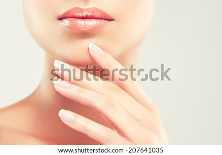 Beauty Spa Woman Portrait. Beautiful Girl Touching her Face - stock photo