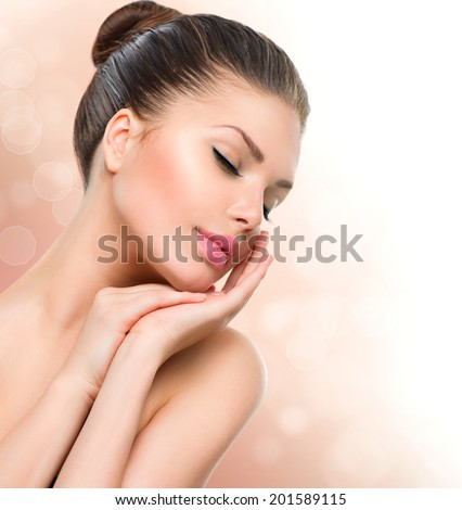 Beauty Spa Woman Portrait. Beautiful Girl Touching her Face. Isolated on white background. Close eyes. Soft skin. Skincare concept