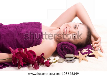Beauty spa woman with flower on background - stock photo