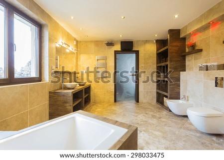 Beauty spacious bathroom interior in designer apartment - stock photo