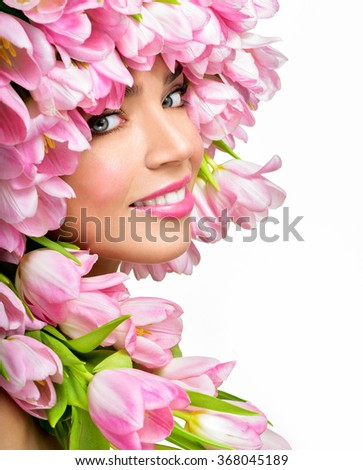 Beauty Spring Girl with Flowers Hair Style.  Spring Flower. Pink tulips.Springtime. Perfect skin