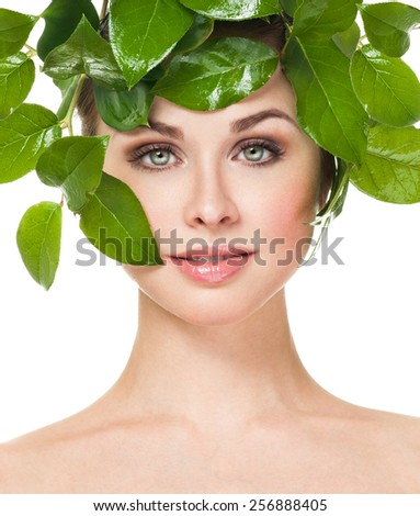Beauty Spring or Woman with Fresh green leaves hair. Summer Nature Girl portrait. - stock photo