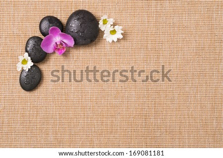 Beauty Still Life With Hot Stone And Flower - stock photo