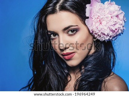 Beauty studio portrait. romantic model woman with peony flowers. high fashion shot.