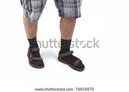 Beauty: studio shot of a man wearing sandals with socks and having hairy legs, isolated on white.