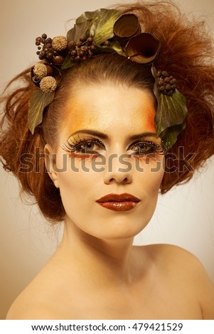 Beauty studio shot redhead woman in autumn makeup