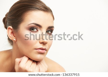 Beauty style portrait of young female model. Isolated woman face on white background.