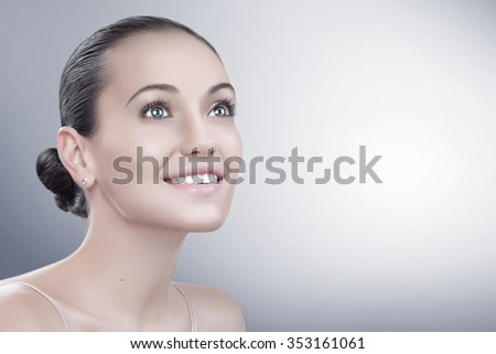 beauty style portrait of young nice woman on blue  back
