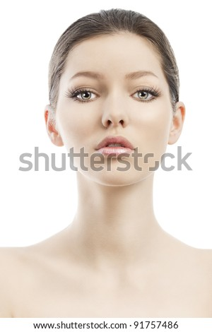 Beauty style portrait of young woman with healthy skin and wet hair . close up on face. she is in front of the camera, looks in to the lens and her face is slightly raised - stock photo