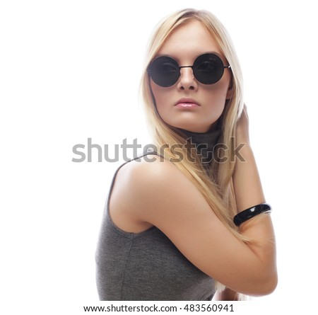 Beauty stylish blonde woman posing in fashionable clothes and bi