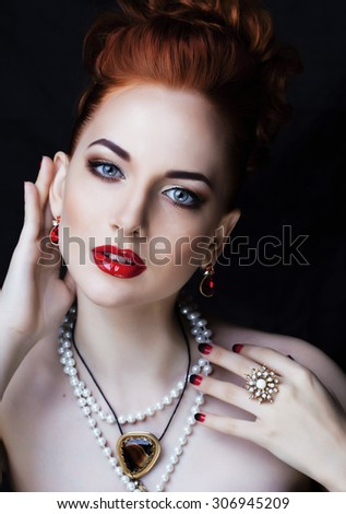 beauty stylish redhead woman with hairstyle and manicure wearing jewelry pearl close up ginger - stock photo