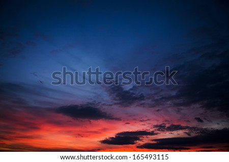 beauty sunset with blue and red clouds - stock photo