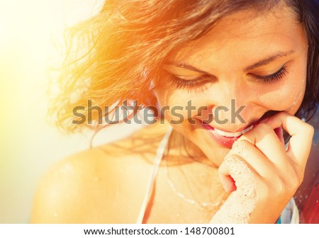 Beauty Sunshine Girl Portrait. Happy Woman Smiling and looking Down. Sunny Summer Day under the Hot Sun on the Beach.  - stock photo
