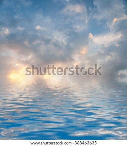 Beauty Surface Rippled of water with clouds and sky background