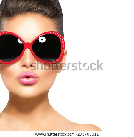 Beauty surprised fashion model girl wearing sunglasses. Young girl. Makeup. Isolated over white background. Beautiful woman portrait, kiss