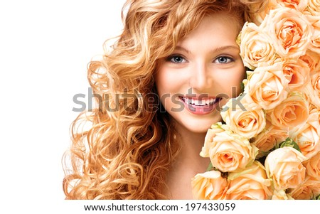 Beauty teenage model girl with curly long hair and bouquet of beautiful roses. Blonde young woman portrait closeup. Isolated on white background. Holiday Hairstyle and makeup - stock photo