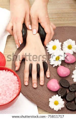 beauty therapist hands massaging hands or manicure - stock photo