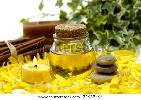 beauty treatment- bottle of massage oil and candle Handmade Soap - stock photo