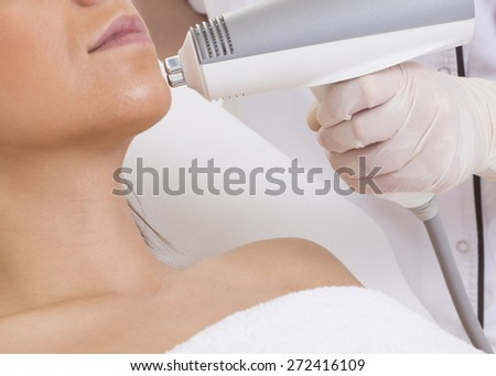 beauty treatment of a young woman in specialized clinic - stock photo