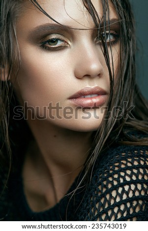 Beauty Vogue Style Fashion Model Girl with Gold Smoky eyes and Wet Hair. Trendy Make-up. Desire - stock photo