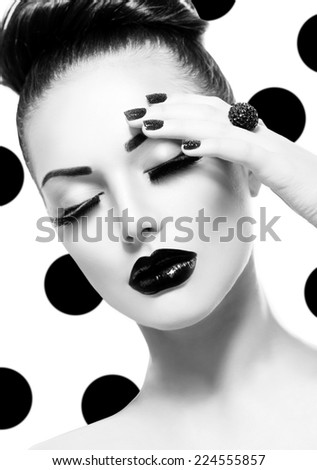 Beauty vogue style fashion model girl with long lushes black manicure and lipstick fashion