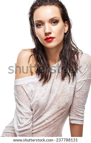 Beauty Vogue Style Fashion Model Girl with Red lips and Wet Skin and Hair on white background. Trendy Make-up. Desire - stock photo