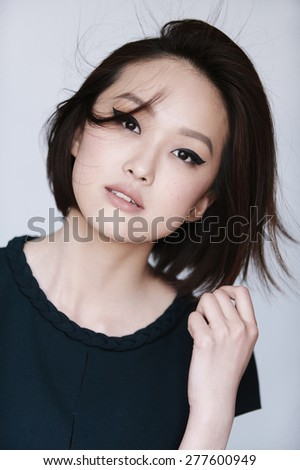 Beauty Vogue Style Fashion Model Girl. Young and beautiful asian woman on white background.