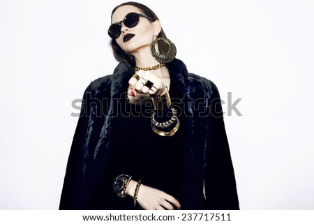 Beauty vogue style fashion model tattoo woman, black lipstick, red nails. Trendy swag clothes and jewelry. Glamour Girl. Professional make up. High Fashion. Dark Lipstick and White Skin. - stock photo