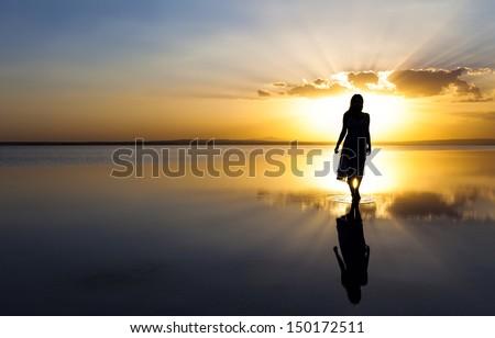 Beauty walking on water  - stock photo