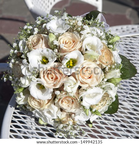 beauty wedding bouquet of roses laying at white chair - stock photo