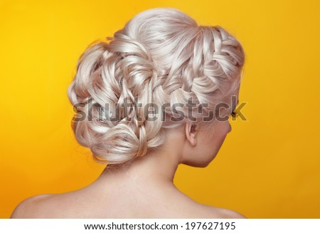 Beauty wedding hairstyle. Bride. Blond girl with curly hair styling - stock photo