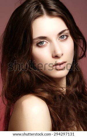 Beauty, wellness, cosmetics, spa. Beautiful woman model face with natural make-up, shiny hair, soft clean skin. Daily look - stock photo