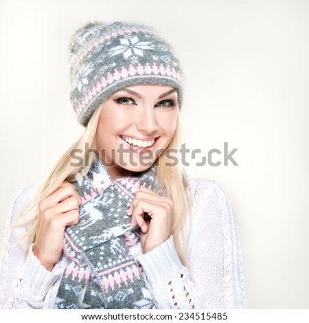 Beauty winter   smiling girl wearing hat and scarf - stock photo