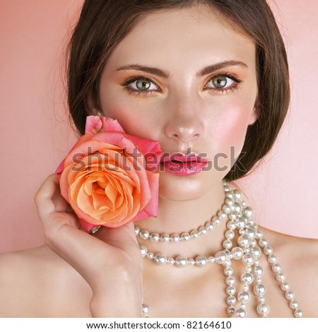 Beauty with a Rose - stock photo
